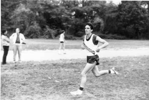 Carl Competing in College.  Curly Hair.  Favorite Shoes.  Striped Tube socks!